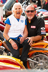 Nonagenarian Gloria Struck and Klock Werks' Brian Klock at the Nonagenarian Gloria Struck with Klock Werks' Brian Klock. Perewitz Paint Show at the Iron Horse Saloon during the Sturgis Black Hills Motorcycle Rally. SD, USA. Wednesday, August 7, 2019. Photography ©2019 Michael Lichter.