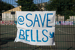 London, UK. 14th August, 2021. A Save Bells banner prepared by local residents and campaigners is displayed on fencing around sports facilities at Bells Gardens in Peckham. Southwark Council proposes to build 97 new homes (a mix of social and private housing), a reprovisioned community facility and a multi-use games area at Bells Gardens, a well-used community park serving the 545-home Bells Gardens estate. Southwark ranks fifth-worst in London and eighth-worst in the UK for easy access to green space.