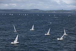 Day 4 NeilPryde Laser National Championships 2014 held at Largs Sailing Club, Scotland from the 10th-17th August.<br /> <br /> Fleets heading upwind across the Clyde<br /> <br /> Image Credit Marc Turner