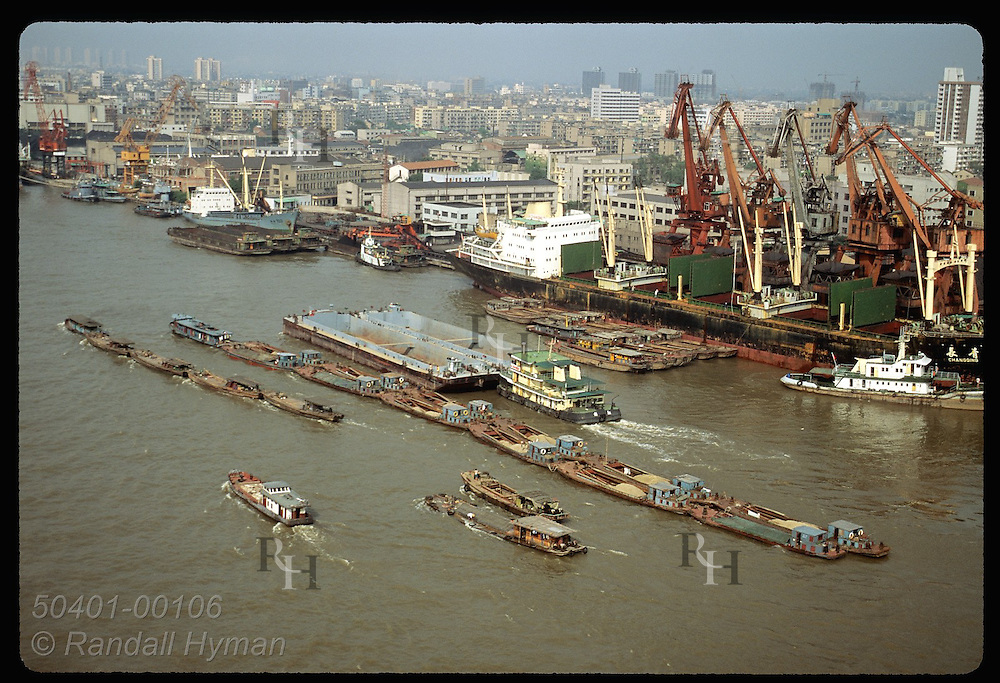 Barges & ocean freighters fill Huangpu River as it flows through Shanghai before joining Yangtze. China