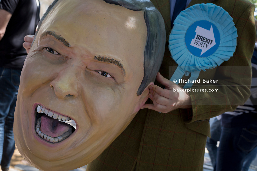 On the day that the Conservative Party elects its leader and the country's Prime Minister, Boris Johnson, a Nigel Farage parody appears outside the QE2 Centre to learn the result, on 23rd July 2019, in Westminster, London, England.