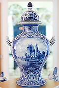 Delft Blue luxury old hand-painted porcelain urn vase at Royal Delft Experience shop in Amsterdam, Holland
