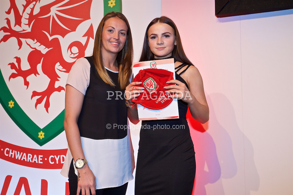NEWPORT, WALES - Saturday, May 21, 2016: Lily Woodham is presented with her Under-16's cap by Wales player Kayleigh Green at the Celtic Manor Resort. (Pic by David Rawcliffe/Propaganda)