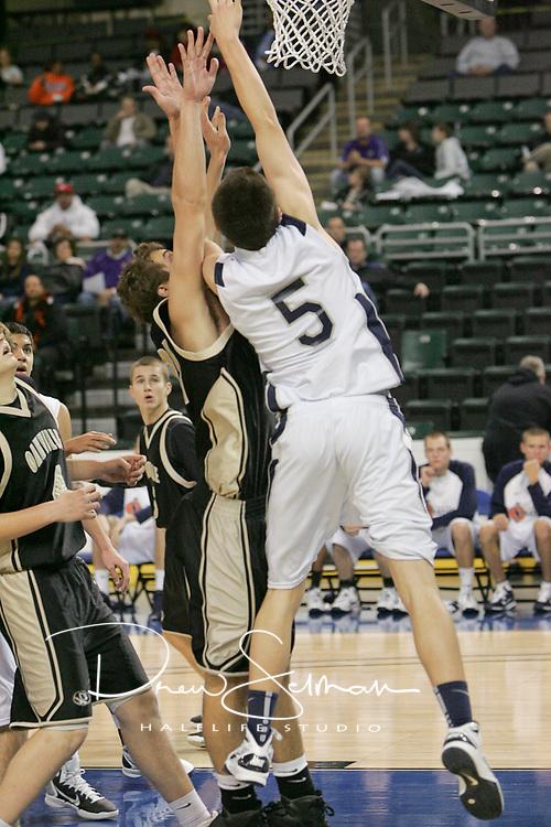 Ryan Howard (5) battles for the rebound.