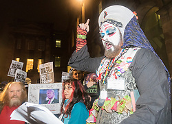 """Hundreds of protesters march through Edinburgh to campaign against incoming US president Donald Trump, coinciding with his inauguration in Washington.<br /> <br /> A Rite of Canonical Indictment & Excommunication of Donald J.Trump is performed by the Order of Perpetual Indulgence and will is conducted by Sister Ann Tici Pation OPI. Similar ceremonies are being performed throughout the world by OPI members.<br /> <br /> The text and structure of this excommunication rite is adapted from one introduced by the Pope Zachary in the 8th Century, as described in the Pontificale Romanum and practiced up until the Second Vatican Council in 1962. The ceremony traditionally involved a bishop, with twelve priests with candles, and is solemnly pronounced in some suitably conspicuous place. The bishop would then pronounce the formula of the anathema. After the pronouncement, the bishop would then ring a bell, close a holy book, and the assisting priests would snuff out their candles by dashing them to the ground, and thus was born the expression """"by bell, book and candle"""".<br /> The Sisters and Brothers of the Order of Perpetual Indulgence are part of a worldwide order of queer people of all sexualities. Formed around 1979 in response to attacks on the queer community by fundamentalist religious organisations, its tenets are: <br /> The expiation of stigmatic guilt, and <br /> The promulgation of universal joy."""
