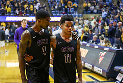 Mar 20, 2019; Morgantown, WV, USA; Grand Canyon Antelopes forward Oscar Frayer (4) and Grand Canyon Antelopes guard Damari Milstead (11) walk off the floor after falling to the West Virginia Mountaineers at WVU Coliseum. Mandatory Credit: Ben Queen