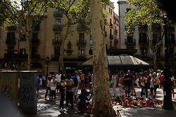 August 26, 2017 - Barcelona, Catalonia, Spain - People display flowers, messages and candles to pay tribute to the victims of the Barcelona and Cambrils attacks in Cambrils on August 26, 2017...The Catalan capital demonstrates under the motto '' I Am not Afraid '', against the terror and in protest to the attack of the Rambla boulevard and Cambrils (Tarragona), which claimed the lives of 15 people the past day 17. The March organized by the City Council of Barcelona and the Government of Catalonia, 878 entities have acceded. (Credit Image: © Juan Carlos Lucas/NurPhoto via ZUMA Press)