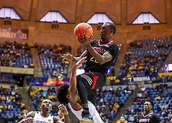 Dec 14, 2019; Morgantown, WV, USA; Nicholls State Colonels guard Dexter McClanahan (22) shoots over West Virginia Mountaineers guard Miles McBride (4) during the first half at WVU Coliseum. Mandatory Credit: Ben Queen-USA TODAY Sports