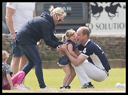June 11, 2017 - Westonbirt, United Kingdom - Image licensed to i-Images Picture Agency. 11/06/2017. Westonbirt, United Kingdom. The Duke of Cambridge hugs Mia Tindall, watched by her mother  Zara Philips at the Gloucestershire Festival of Polo  at Beaufort Polo Club in Westonbirt, Gloucestershire, United Kingdom. Picture by Stephen Lock / i-Images (Credit Image: © Stephen Lock/i-Images via ZUMA Press)