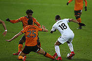 Jordan Ayew of Swansea city beats and goes past several Wolverhampton Wanderers players to score his teams 1st goal, with many people comparing his solo run and goal to a Ricky Villa FA cup goal of the past. The Emirates FA Cup, 3rd round replay match, Swansea city v Wolverhampton Wanderers at the Liberty Stadium in Swansea, South Wales on Wednesday 17th January 2018.<br /> pic by  Andrew Orchard, Andrew Orchard sports photography.