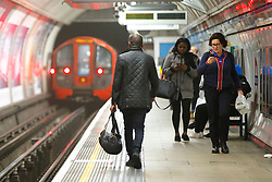 © Licensed to London News Pictures. 08/01/2017. London, UK. Passengers travel as London Underground services are severely disrupted due to members of RMT and TSSA start a 24 hour strike action in a dispute over jobs cuts and closed ticket offices on Sunday, 8 January 2017. The strike action also will be effective all day on Monday, 9 January 2017. Photo credit: Tolga Akmen/LNP