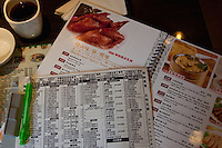 chinese menu on a table top during a meal in shanghai