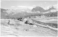 """West side (southbound) view of Lizard Head with snowshed, section house, and snow fences.  Work train is on siding.<br /> RGS  Lizard Head, CO  Taken by Richardson, Robert W. - 10/11/1952<br /> In book """"Silver San Juan: The Rio Grande Southern"""" page 570<br /> Also in Lind's """"Narrow Gauge Country"""", p. 123 and """"Narrow Gauge Land"""", p. 127."""
