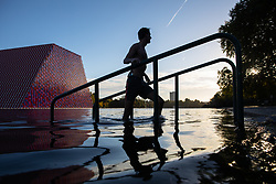 October 1, 2018 - London, London, UK - London, UK. A swimmer leaves the Serpentine Lido in Hyde Park at sunrise this morning. Temperatures in the capital were cold this morning, but are set to reach over 20 degrees Celsius later this week, higher than average for the time of year. (Credit Image: © Tom Nicholson/London News Pictures via ZUMA Wire)