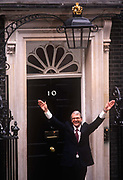 Prime Minister, John Major celebrates at the door of 10 Downing Street, returning to power after his re-election after replacing Margaret Thatcher, on 10th April 1992, in London England. Majors win was the fourth consecutive victory for the Conservative Party although it was its last outright win until 2015 after Labours 1997 win for Tony Blair.
