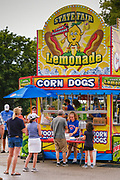 26 JULY 2020 - DES MOINES, IOWA: at the State Fairgrounds in Des Moines. This year's Iowa State Fair was cancelled because of the COVID-19 (SARS-CoV-2) pandemic. Several fair food vendors set opened outside the fairgrounds and this weekend, the fair opened the Midway area to a selection of food vendors, who served take away style. People were encouraged to social distance and wear face masks to help control the spread of Coronavirus, which is surging in Iowa.      PHOTO BY JACK KURTZ