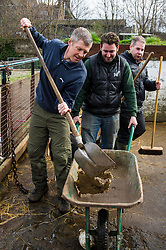 Pictured: Willie Rennie helped volunteer manager Callum MIll in mucking out the pen shared by Berkshire and Gloucestershire Old Spots boars.<br /> <br /> Scottish Liberal Democrat leader Willie Rennie called for a boost to vocational training opportunities when he met volunteers, Leah Muirhead and Graham Mathieson, at Gorgie City Farm in Edinburgh. After touring the farm, which provides volunteering and training opportunities for at-risk young people and adults with additional support needs, Mr Rennie set out Lib Dem plans to increase opportunities for industry-recognised vocational qualifications.  <br /> Ger Harley | EEm 8 April 2016