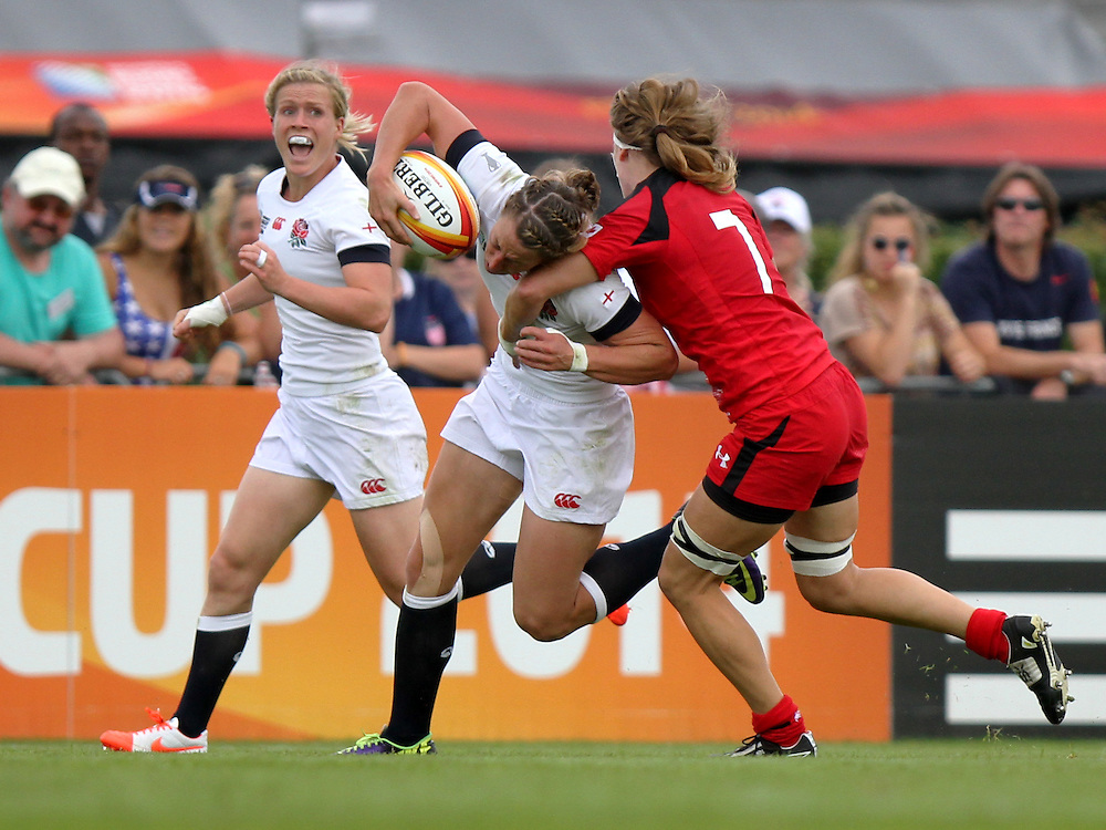 Kat Merchant tackled. England v Canada Pool A match at WRWC 2014 at Centre National de Rugby, Marcoussis, France, on 9th August 2014