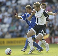 Photo: Aidan Ellis.<br /> Preston North End v Cardiff City. Coca Cola Championship. 09/09/2006.<br /> Cardiff's Michael Chopra (L) battles with Preston's Liam Chilvers