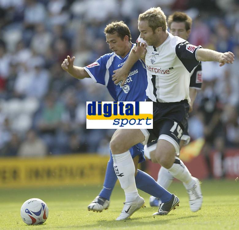 Photo: Aidan Ellis.<br /> Preston North End v Cardiff City. Coca Cola Championship. 09/09/2006.<br /> Cardiff's Michael Chopra (L) battles with Preston's Liam Chilvers