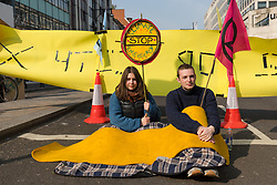 © Licensed to London News Pictures. 17/04/2019. Environmental activists from the Extinction Rebellion movement continute to protest and block the road at Oxford Circus as part of a series of direct actions taking place across the capital. The protests demand urgent action from governments on climate change. Photo credit: Vickie Flores/LNP