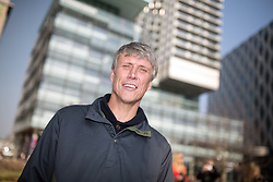 © Licensed to London News Pictures . 19/03/2015 . Salford Quays , UK . BEZ ( Mark Berry ) at Salford's Media City . Black Grape photocall at The Green , Salford Quays , Greater Manchester . Black Grape are reforming for a Madchester charity gig along with other local bands , to raise awareness for Bez's Reality Party and anti-fracking . Photo credit : Joel Goodman/LNP