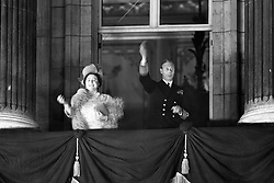 King George VI and Queen Elizabeth acknowledge the crowds on the balcony of Buckingham Palace.