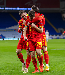 CARDIFF, WALES - Wednesday, November 18, 2020: Wales' Daniel James (R) celebrates with team-mates Harry Wilson (L) and Connor Roberts (C) after scoring the second goal during the UEFA Nations League Group Stage League B Group 4 match between Wales and Finland at the Cardiff City Stadium. Wales won 3-1 and finished top of Group 4, winning promotion to League A. (Pic by David Rawcliffe/Propaganda)