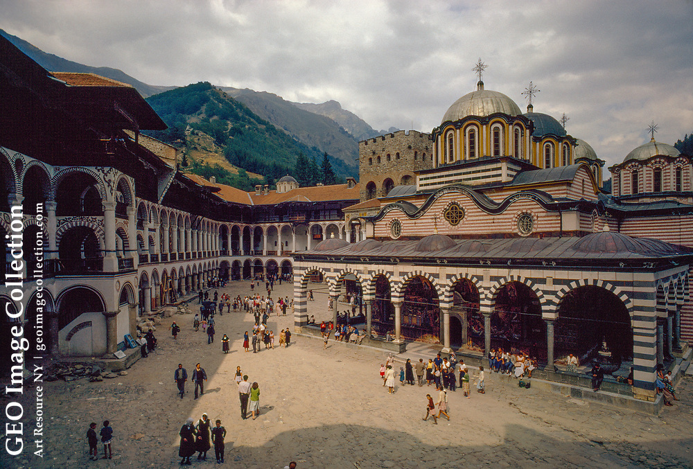 The courtyard and mountains beyond the Rila Monastery, in Bulgaria.