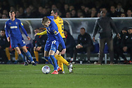 AFC Wimbledon striker Joe Pigott (39) battles for possession with Southend United manager Sol Campbell looking on from the sidelines during the EFL Sky Bet League 1 match between AFC Wimbledon and Southend United at the Cherry Red Records Stadium, Kingston, England on 1 January 2020.