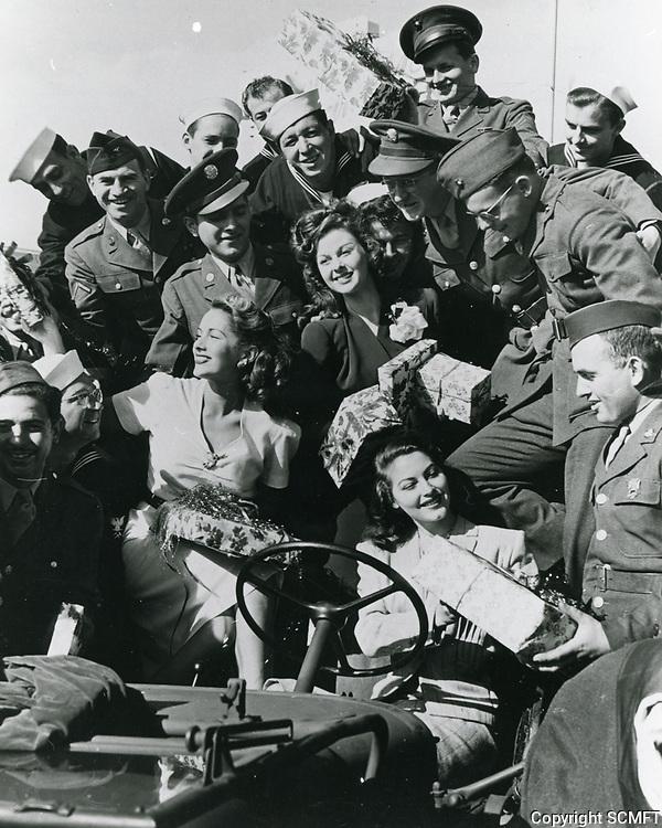 1944 Jinx Falkenberg, Susan Hayward and Ava Gardner hand out Christmas presents at the Hollywood Canteen