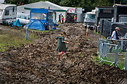 Heavy rain created a mud bath in the Shangri La camping field, Glastonbury Festival 2016. Glastonbury Festival is the largest greenfield festival in the world, and is now attended by around 175,000 people. Its a five-day music festival that takes place near Pilton, Somerset, United Kingdom. In addition to contemporary music, the festival hosts dance, comedy, theatre, circus, cabaret, and other arts. Held at Worthy Farm in Pilton, leading pop and rock artists have headlined, alongside thousands of others appearing on smaller stages and performance areas.