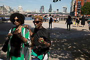 Two stylish women wearing black and green. The South Bank is a significant arts and entertainment district, and home to an endless list of activities for Londoners, visitors and tourists alike.