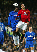 Photograph: Scott Heavey.<br />Chelsea v Manchester United. FA Barclaycard Premiership. 30/11/2003.<br />Mario Melchiot out-jumps Ruud Van Nistlerooy