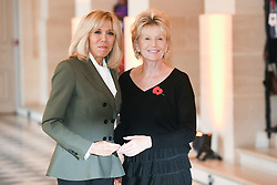 French President's wife Brigitte Macron welcomes New Zealand's vice Prime Minister partner Jan Trotman as they take part in a spousal event at the Chateau de Versailles in Versailles, near Paris, on November 11, 2018 as part of commemorations marking the 100th anniversary of the 11 November 1918 armistice, ending World War I. Photo By Laurent Zabulon/ABACAPRESS.COM