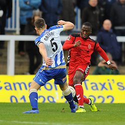 TELFORD COPYRIGHT MIKE SHERIDAN 12/1/2019 - Dan Udoh of AFC Telford takes on Carl Magnay during the Vanarama Conference North fixture between AFC Telford United and Hartlepool United at the Super Six Stadium.