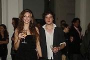 Tamsin Egerton and Jamie Taylor, USA Today. Saatchi Gallery and The Royal academy of Arts. Piccadilly. London. 5 October 2006. -DO NOT ARCHIVE-© Copyright Photograph by Dafydd Jones 66 Stockwell Park Rd. London SW9 0DA Tel 020 7733 0108 www.dafjones.com