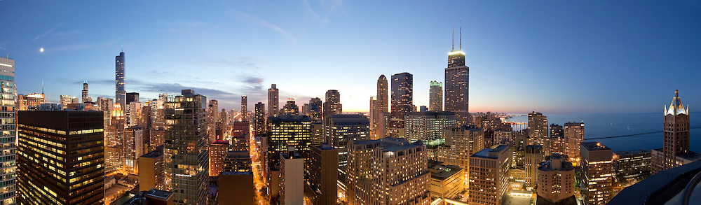 Chicago Panoramic Skyline at Dusk looking Southwest, West and North with Willis Tower, Trump Tower, Hancock Building and Lake Michigan from 45th floor of a Streeterville apartment building.