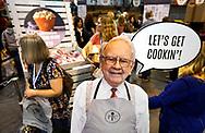 Berkshire Hathaway shareholders walks by a photo of CEO Warren Buffett at the shareholder shopping day as part of the Berkshire Hathaway annual meeting weekend in Omaha, Nebraska May 5 2017. REUTERS/Rick Wilking