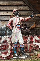 Lawn jockey, Heidelberg Project, Detroit, Michigan.  The Heidelberg Project is a grass roots project started by artist Tyree Guyton that uses art to help revitalize the embattled neighborhood.  Each year, over 275,000 people visit the project .  For more information, go to www.heidelberg.org