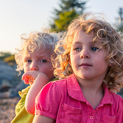 A young girl and her little brother on East Gosling Island in Casco Bay, Harpswell, Maine.