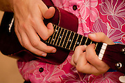 Close-up of hands playing a ukelele