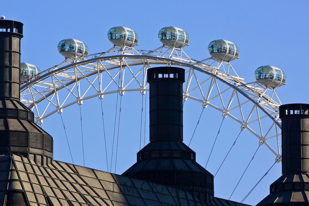 British Airways London Eye seen above rooftops, England, United Kingdom