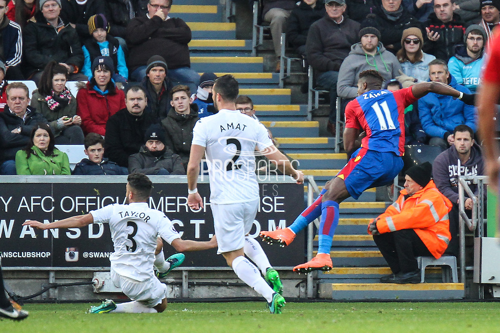 Wilfried Zaha of Crystal Palace scores his teams first goal during the Premier League match between Swansea City and Crystal Palace at the Liberty Stadium, Swansea, Wales on 26 November 2016. Photo by Andrew Lewis.