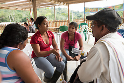 """16 November 2018, San José de León, Mutatá, Antioquia, Colombia: """"In one way, one of our biggest threats today is the state,"""" explains Maribel David Galiano, president of the community board of San José de León. """"For example, as we are in an area that is very rich in clean water, to make sure the state doesn't allow mining companies or others to exploit or damage this resource. But also that people know about the reality of life in our communities, that we are people who want to work, live in peace, who want our communities to develop."""" Following the 2016 peace treaty between FARC and the Colombian government, a group of ex-combatant families have purchased and now cultivate 36 hectares of land in the territory of San José de León, municipality of Mutatá in Antioquia, Colombia. A group of 27 families first purchased the lot of land in San José de León, moving in from nearby Córdoba to settle alongside the 50-or-so families of farmers already living in the area. Today, 50 ex-combatant families live in the emerging community, which hosts a small restaurant, various committees for community organization and development, and which cultivates the land through agriculture, poultry and fish farming. Though the community has come a long way, many challenges remain on the way towards peace and reconciliation. The two-year-old community, which does not yet have a name of its own, is located in the territory of San José de León in Urabá, northwest Colombia, a strategically important corridor for trade into Central America, with resulting drug trafficking and arms trade still keeping armed groups active in the area. Many ex-combatants face trauma and insecurity, and a lack of fulfilment by the Colombian government in transition of land ownership to FARC members makes the situation delicate."""