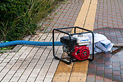 Gasoline operated Centrifugal engine-driven pump is pumping wastewater from a flooded area