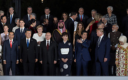 Indonesia's President Joko Widodo, Canada's Prime Minister Justin Trudeau's wife Sophie Gregoire, China's President Xi Jinping, Germany's Chancellor Angela Merkel, Russia's President Vladimir Putin, Saudi Arabia's Crown Prince Mohammed bin Salman, Japan's Prime Minister Shinzo Abe's wife Akie Abe and Japan's Prime Minister Shinzo Abe and US President Donald Trump during family photo session on the first day of the G20 summit in Osaka, Japan on June 28, 2019. Photo by Jacques Witt/Pool/ABACAPRESS.COM