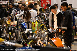 Crowds studied and took photos of everything at the 27th Annual Mooneyes Yokohama Hot Rod Custom Show 2018 as it was so packed with spectacular custom bikes and hot rods. Yokohama, Japan. Sunday, December 2, 2018. Photography ©2018 Michael Lichter.