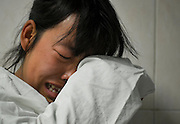 CHONGQING, CHINA - FEBRUARY 24: (CHINA OUT)<br /> <br /> Heart breaking moment Parents make the decisionto Donate Organs Of Their Son Diagnosed As Brain Death In Traffic Accident<br /> <br /> Mother of 15 months\' old boy Huang Zihan has a tearful final meeting with their son at West China Hospital of Sichuan University on February 24, 2015 in Chengdu, Sichuan province of China. A 15 months\' old boy named Huang Zihan and his parents Huang Yun and Liu Pingfen encountered a traffic accident on their way back to working city of Xichang on the last day of Spring Festival holiday while the van they took turned over to a 10-meter deep river valley when passing a bridge. Huang Zihan was diagnosed as brain death after being sent to West China Hospital of Sichuan University. Even heart stricken, Huang Yun and Liu Pingfen decided to donate organs of his son and a child in Children\'s Hospital of Chongqing Medical University accepted the liver successfully.<br /> ©Exclusivepix Media
