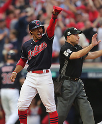 October 6, 2017 - Cleveland, OH, USA - The Cleveland Indians' Francisco Lindor celebrates after scoring against the New York Yankees on a hit by Carlos Santana in the first inning during Game 2 of the American League Division Series, Friday, Oct. 6, 2017, at Progressive Field in Cleveland. (Credit Image: © Phil Masturzo/TNS via ZUMA Wire)
